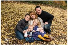 family and fall leaves
